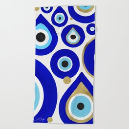 Evil Eye Charms on White Beach Towel