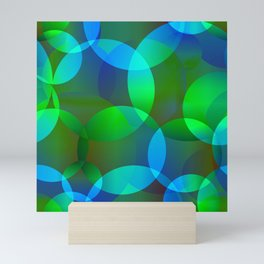 Abstract soap from space yellow and green bright circles and bubbles on a luminous background. Mini Art Print