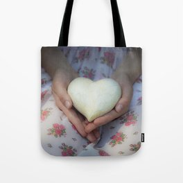 Hands holding a heart Tote Bag