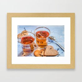 Black tea in two small tea glasses with heart shaped ginger cookies on pastel background Framed Art Print