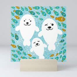 happy family of white seals and fish on a blue background. Mini Art Print