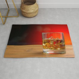 Glass of Whisky With Ice on a Wooden Table Rug
