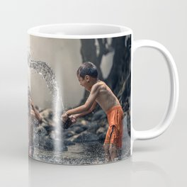 Asian baby play in a river Coffee Mug
