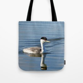 Western Grebe on calm water Tote Bag