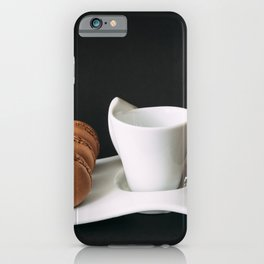 Set of cup of coffee and macaroons against black background iPhone Case