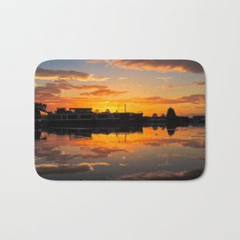 Sunrise arcross the water Bath Mat