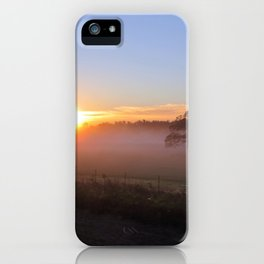 SOLITARY TREE ENCASED IN FOG WITH SUN RISING iPhone Case