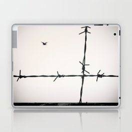 Freedom, a seagull is flying totally free beyond a spiked wire. Laptop & iPad Skin