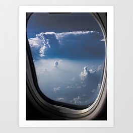 cloudy sky through aeroplane window Art Print