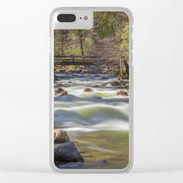 A bridge over the Merced River stands solidly over the velvety exposure of the water Clear iPhone Case