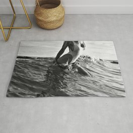 Alone at the Beach in Malibu, female form exiting ocean black and white photography Rug