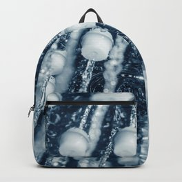 Shower head with running water closeup Backpack