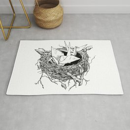 birds made of paper in a nest Rug