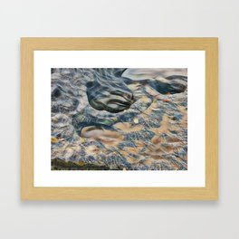 Abstract eroded rocks on beach with puddle Framed Art Print