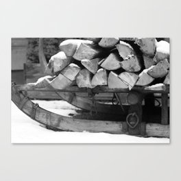 Sled with firewood, black and white photo Canvas Print