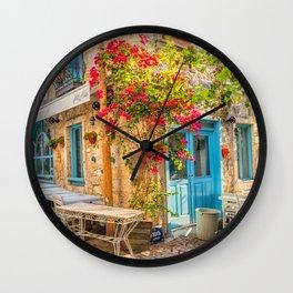 Bougainvillaea growing up the wall of a restaurant in Alacati, Izmir, Turkey Wall Clock