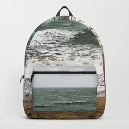 Land and sea under stormy clouds Backpack