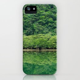 Calming greenery reflecting in perfectly still and tranquil river, Iriomote-jima, Japan iPhone Case