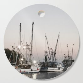 Fishing Boats on the Water at Sunset Cutting Board