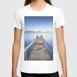 Wooden pier or jetty and lake at sunrise. Torre del Lago Puccini. Tuscany, Italy T-shirt