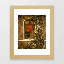 Red sweater in the window of the house Framed Art Print