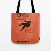 gravity Tote Bags featuring GRAVITY by Resistance