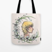 enjolras Tote Bags featuring Enjolras and lilies by MonsterFromTheLAke