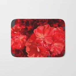 Decorative Red Geraniums On Grey Bath Mat