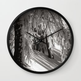Sunlight through winter forest trees, new snowfall black and white photograph / photography by Rudolf Koppitz Wall Clock