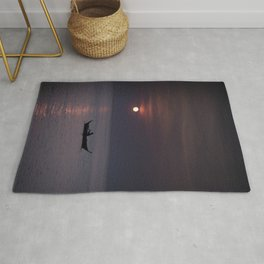 Rowing into the sunset Rug