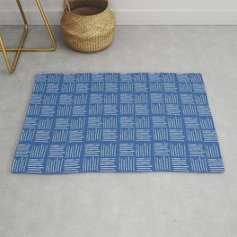 Geometrical grey lines pattern on blue Rug