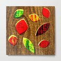 colored leafs on wood by hennigdesign