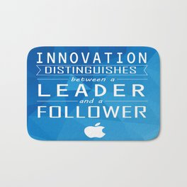 Innovation distinguishes between a leader and a follower Business Inspirational Quote Bath Mat