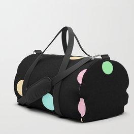 Floating Pastel Candies on Black Duffle Bag
