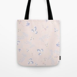 Spring watercolor leaves on peach background Tote Bag