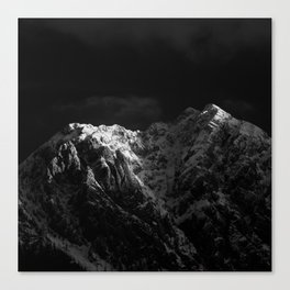 Sunlight hitting the mountains black and white Canvas Print