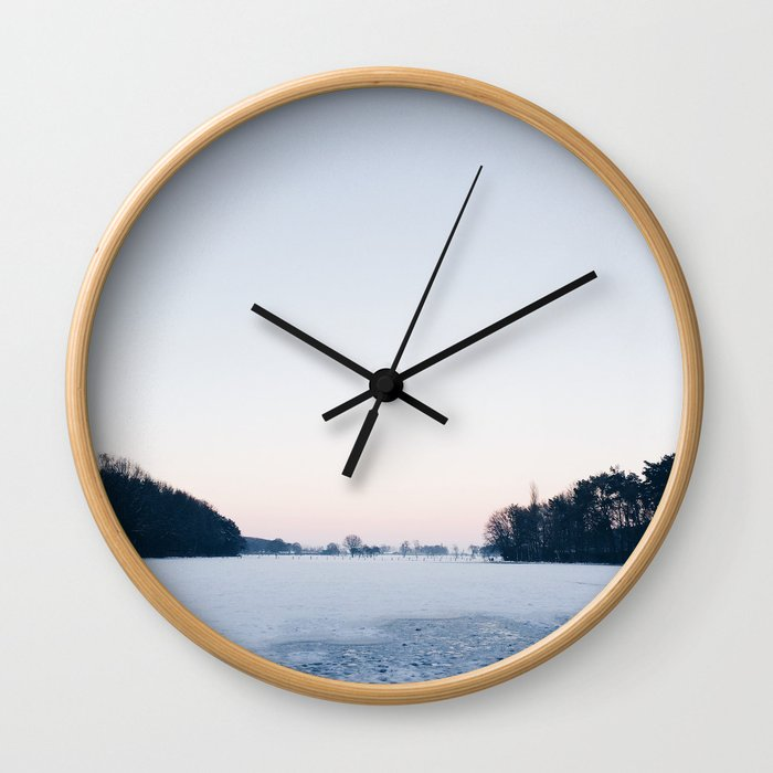 Snow: A Winter Sunset Full of Pink, White & Blue Wall Clock
