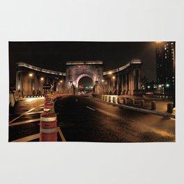 manhattan bridge at night Rug