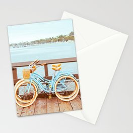 Two retro bicycles standing on Santa Barbara pier, California, USA. Vintage filter with muted teal blue and orange colors. Stationery Cards