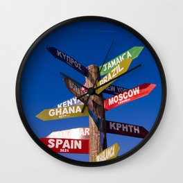 Travel direction road post Wall Clock