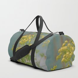 Yellow wildflowers on blue rusty metal Duffle Bag