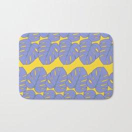 Digital illustration pattern with organic purple leafs on yellow Bath Mat
