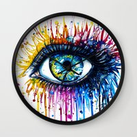 "shipping Wall Clocks featuring ""Rainbow Eye"" by PeeGeeArts"