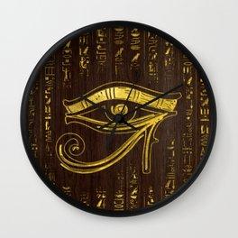 Golden Egyptian Eye of Horus  and hieroglyphics on wood Wall Clock