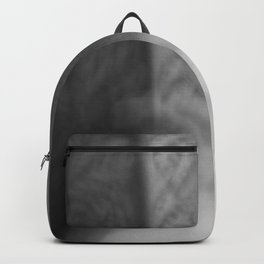 man in a ghost state of mind on couch Backpack