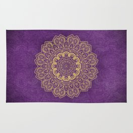 Golden Flower Mandala on Textured Purple Background Rug