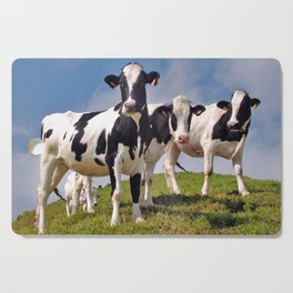 Young Holstein cows Cutting Board