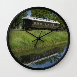 Sitting on a siding Wall Clock
