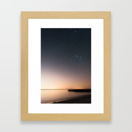 Beautiful starry scene at the coast of 'Colonia, Uruguay'. Long exposure with light pollution. Framed Art Print