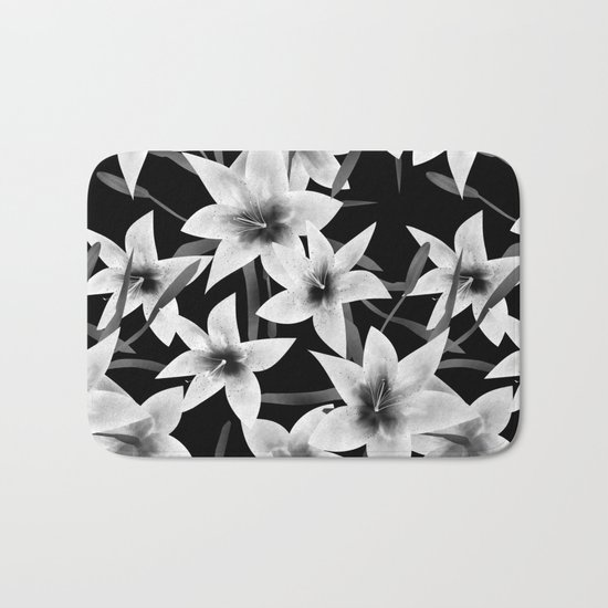 White lilies on a black background . Bath Mat